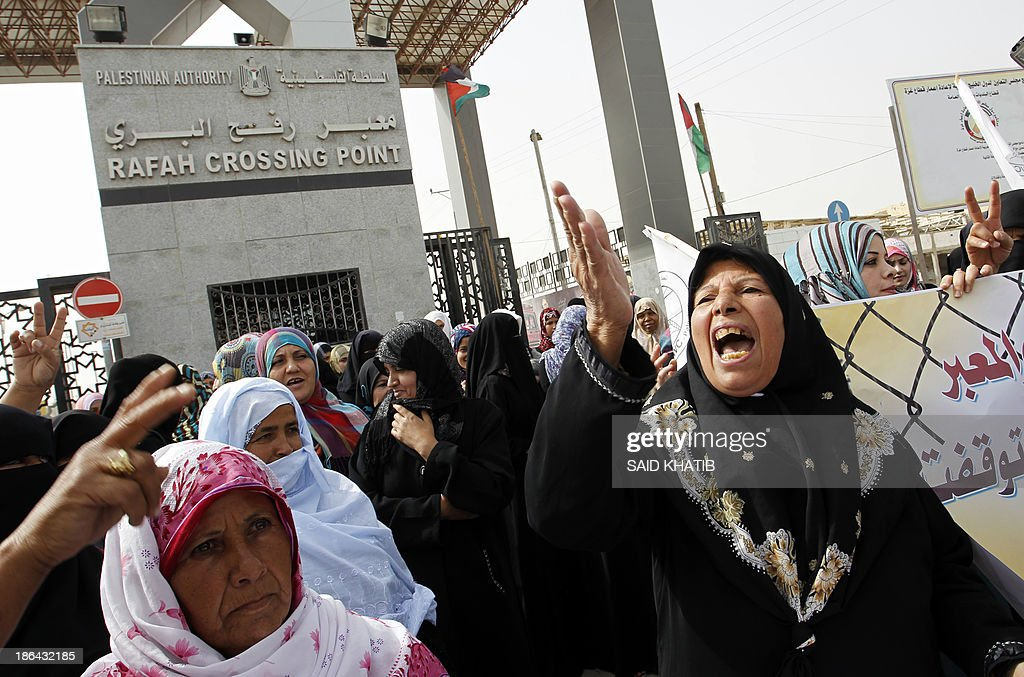 Palestinian women take part in a rally in front of the Rafah border crossing with Egypt in the southern Gaza Strip on October 31, 2013, demanding the permament and unconditional opening of the crossing. Egypt occasionally permits people to enter and leave Gaza, but has refused to open on a permanent basis the only border crossing in the Hamas-run Palestinian coastal strip not controlled by Israel.
