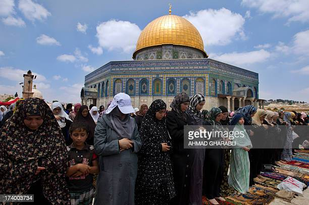 Palestinian women take part in Friday prayers during the holy Muslim month of Ramadan at AlAqsa Mosque compound in Jerusalem on July 19 2013 US...