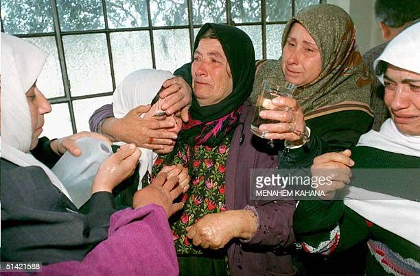 Palestinian women try to comfort 22yearold Amal after she was told that her husband Hamas militant Nasri Hureimi was shot dead by Israeli troops...