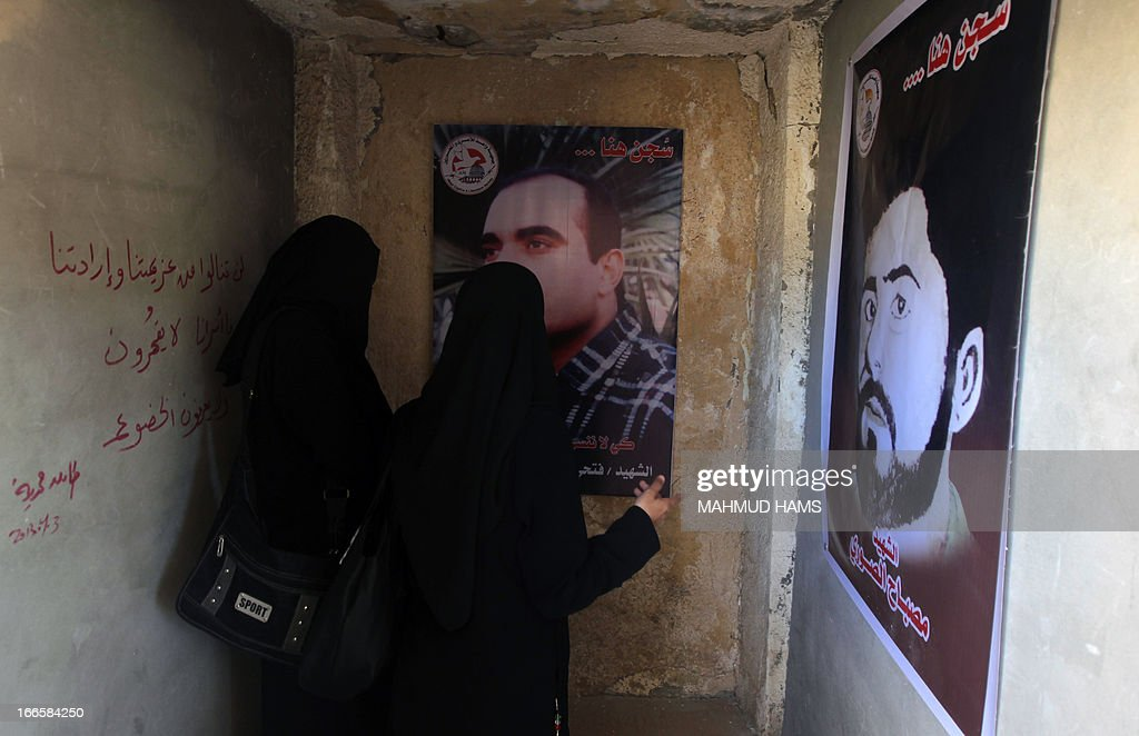 Palestinian women visit a building which used to be an Israeli prison to keep Palestinians during Israel's occupation of Gaza, on April 14, 2013, as part of a tour organized by Hamas to show the facility that has now turned into a memorial center, in Gaza City. Israel has evacuated its settlements and army posts in the Gaza Strip in 2005. AFP PHOTO MAHMUD HAMS