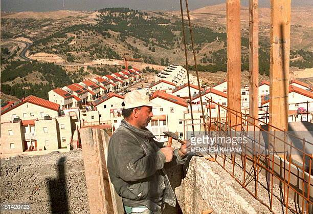 MA'ALE ADUMIM ISRAEL A Palestinian worker builds a new house at the Maale Adumim Jewish settlement near Jerusalem 23 December 1994 On 22 December...