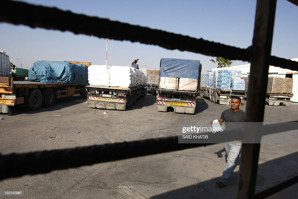 A Palestinian worker checks a truck carrying supplies after it arrived in Rafah town through the Kerem Shalom crossing between Israel and the southern Gaza Strip on June 16, 2010 as Israel's security cabinet met to consider an international proposal for significantly easing its blockade on Gaza Strip, which has been in place since 2006.