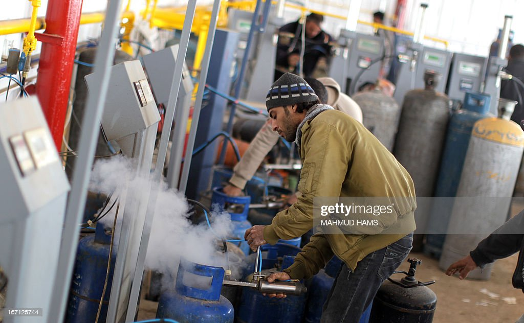 Palestinian worker refill empty gas bottles at a warehouse in Gaza City on April 21, 2013. The Gaza Strip has been facing a gas crisis for the past two months partially due to the frequent closure of their border crossings by neighboring Israel.