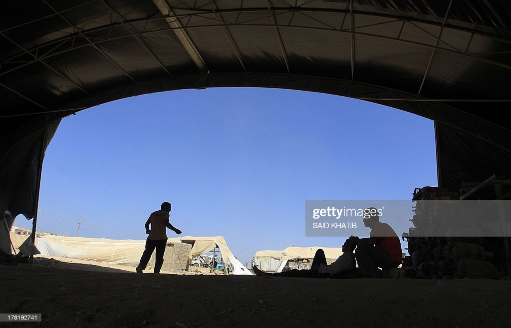 A Palestinian worker rests at the entrance of a smuggling tunnel dug beneath the Gaza-Egypt border in the southern Gaza Strip on August 27, 2013. Egyptian security forces have stepped up a crackdown campaign on smuggling tunnels between Egypt and the Gaza Strip since July, Hamas officials said.