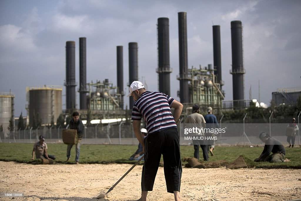 Palestinian workers lay turf close to a power station in Gaza City, on November 2, 2013. A shortage of fuel halted the production of electricity across the Gaza Strip, said the energy authority of the Islamist movement Hamas, which controls the Palestinian enclave.