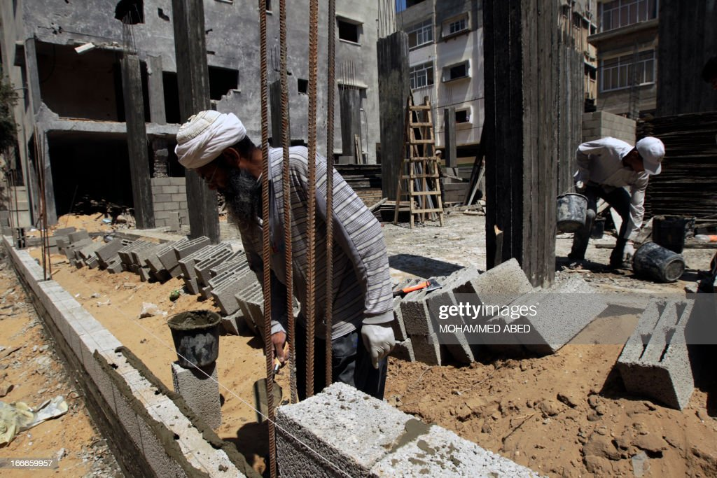 Palestinian workers rebuild a house in Gaza City in which Mohammed al-Dallu, a Hamas policeman described by the Israeli army as a terrorist, was killed along with nine other members of his family and two neighbours during Israel's last November Gaza campaign, on April 15, 2013. The Israeli military has closed probes into more that 60 allegations of misconduct during its November Gaza campaign, including a strike that killed 12, among them five women and five children. The eight-day offensive against Gaza militants, codenamed 'Operation Pillar of Defence' by Israel, claimed the lives of 177 Palestinians, including over 100 civilians, and six Israelis, two of them soldiers, according to sources on both sides.