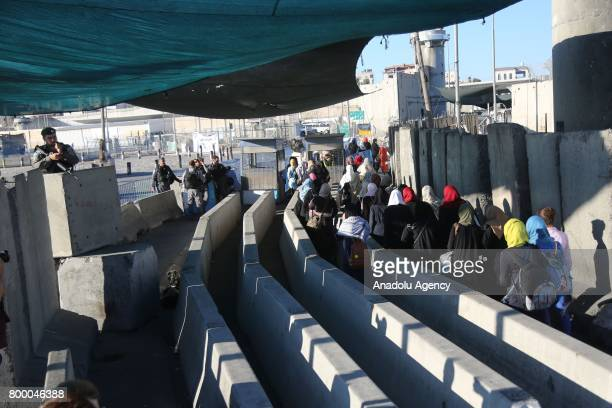 Palestinian worshippers mostly from women line up for passing through the Qalandiya checkpoint from Ramallah into Jerusalem after Israeli authorities...