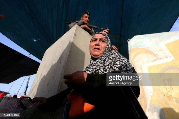 Palestinian worshippers mostly from women move for passing through the Qalandiya checkpoint from Ramallah into Jerusalem after Israeli authorities...