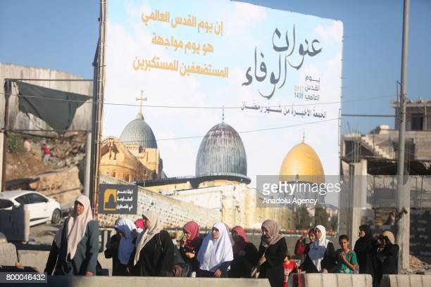 Palestinian worshippers mostly from women pass through the Qalandiya checkpoint from Ramallah into Jerusalem after Israeli authorities let the...