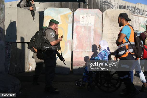Palestinian worshippers mostly from women wait in a queue for passing through the Qalandiya checkpoint from Ramallah into Jerusalem after Israeli...
