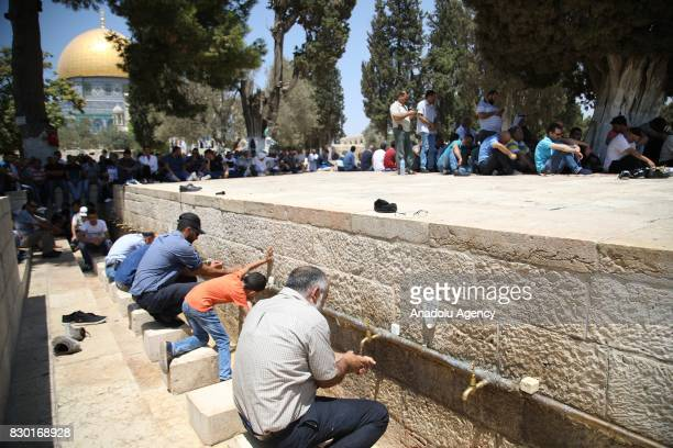 Palestinian worshippers perform ablution ahead of the Friday prayer at Al Aqsa Mosque following lifting of Israeli restrictions on AlAqsa in...