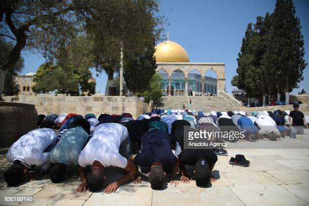 Palestinian worshippers perform Friday prayer at Al Aqsa Mosque following lifting of Israeli restrictions on AlAqsa in Jerusalem on August 11 2017