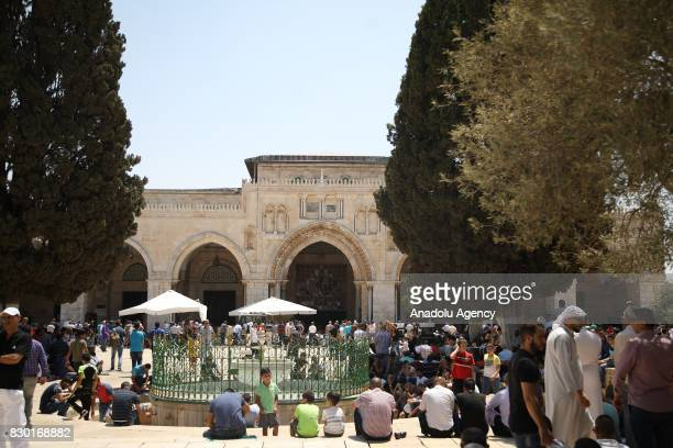 Palestinian worshippers wait for the Friday prayer at the courtyard of Al Aqsa Mosque following lifting of Israeli restrictions on AlAqsa in...