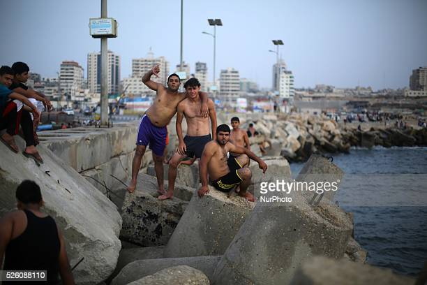 Palestinian Young jump into the Mediterranean