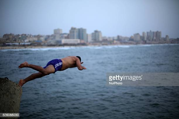 Palestinian Young jump into the Mediterranean sea in Gaza on 10 september 2015