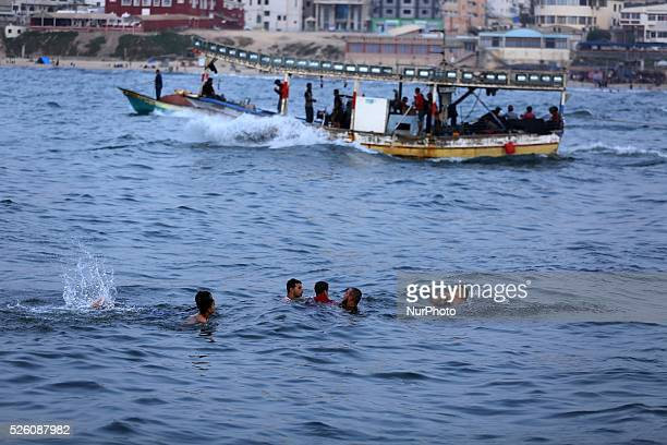 Palestinian Young swim on a warm day in the Mediterranean Gaza 10 september 2015