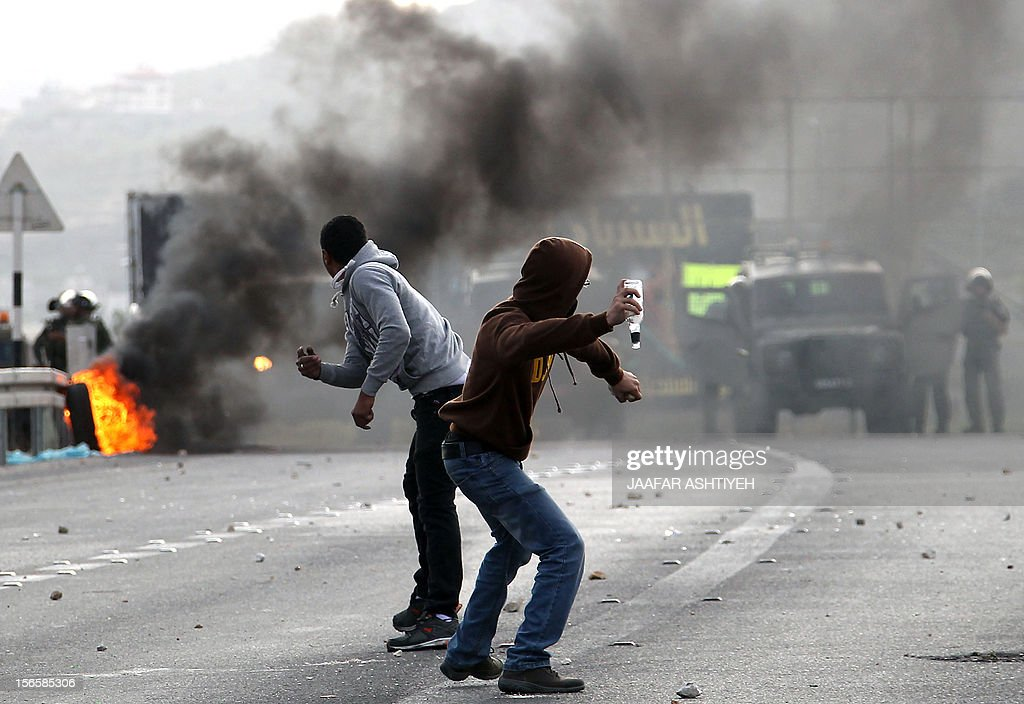 Palestinian youth clash with Israeli soldiers during protests at the Hawara checkpoint in the occupied West Bank city of Nablus, on November 17, 2012. Palestinians took to the streets to demonstrate against the Israeli military operation on the Gaza Strip which has seen some 40 people killed in the past 4 days including Palestinian children.