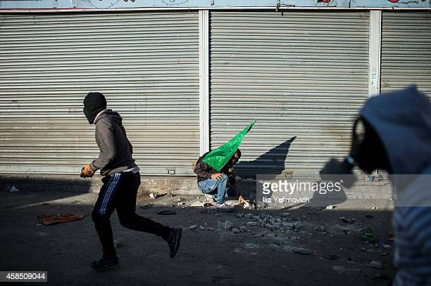 Palestinian youth clash with police at Shuafat refugee camp a day after a Palestinian resident of the camp was named as the driver of a van that...