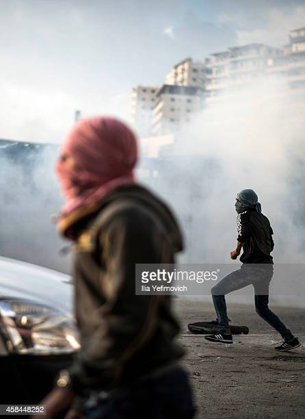 Palestinian youth clash with police at Shuafat refugee camp after a Palestinian resident of the camp was named as the driver of a van that rammed...