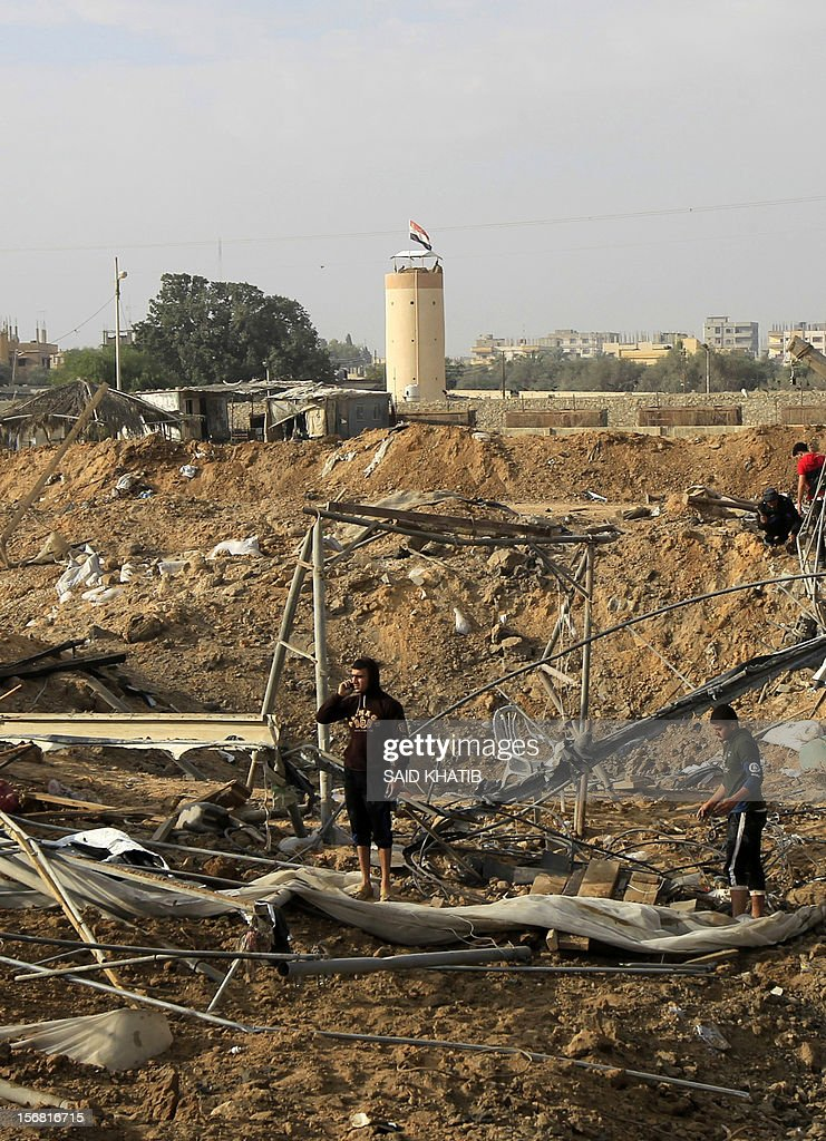 Palestinian youth inspect destroyed tents near bombed smuggling tunnels between the southern Gaza Strip and Egypt in the border town of Rafah on November 22, 2012. A ceasefire took hold in and around Gaza after a week of cross-border violence between Israel and Palestinian militants that killed at least 160 people. AFP PHOTO/ SAID KHATIB