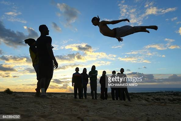 TOPSHOT Palestinian youth show their skills on the beach in Rafah in the southern Gaza Strip on February 17 2017 / AFP / MOHAMMED ABED