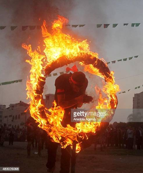 Palestinian youth shows his skills during a graduation ceremony of the Hamas' military summer camp in Gaza City on August 05 2015