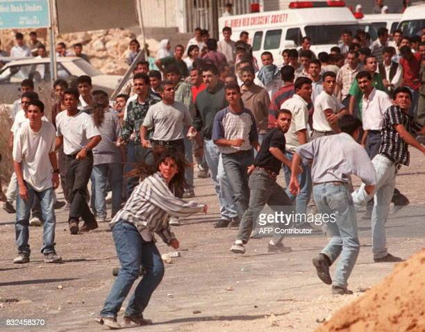 Palestinian youth throw stones during a protest at an Israeli army checkpoint near Ramallah town of the West Bank 25 September More than 140...