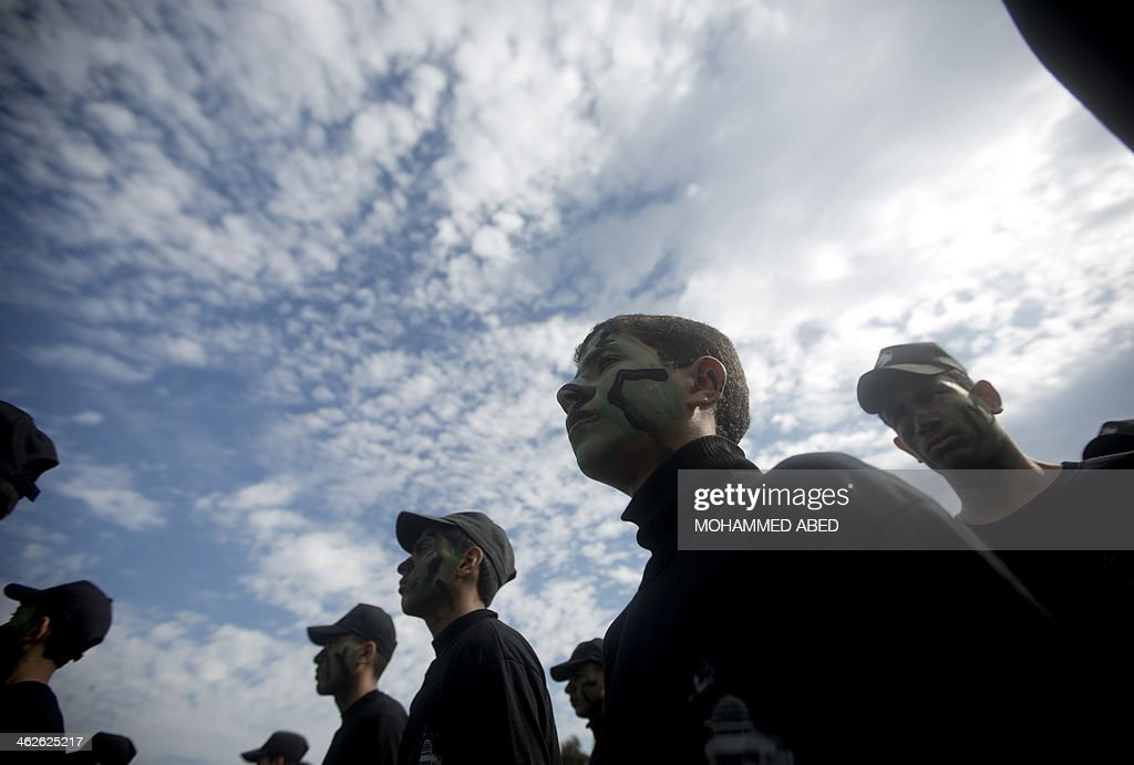 Palestinian youths attend a graduation ceremony for a military-style training programme in Gaza City on January 14, 2014. Some 13,000 students joined the course, which is aimed at preparing them for 'liberating Palestine from Israel', Hamas officials said.