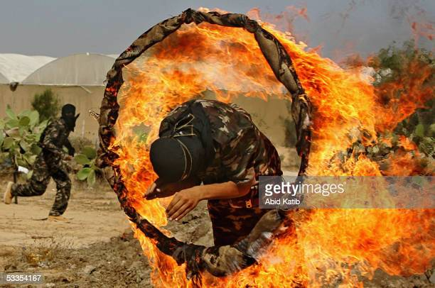 Palestinian youths attend military exercise during a summer camp organized by The Islamic Resistance Movement August 11 2005 in Rafah refugee camp...