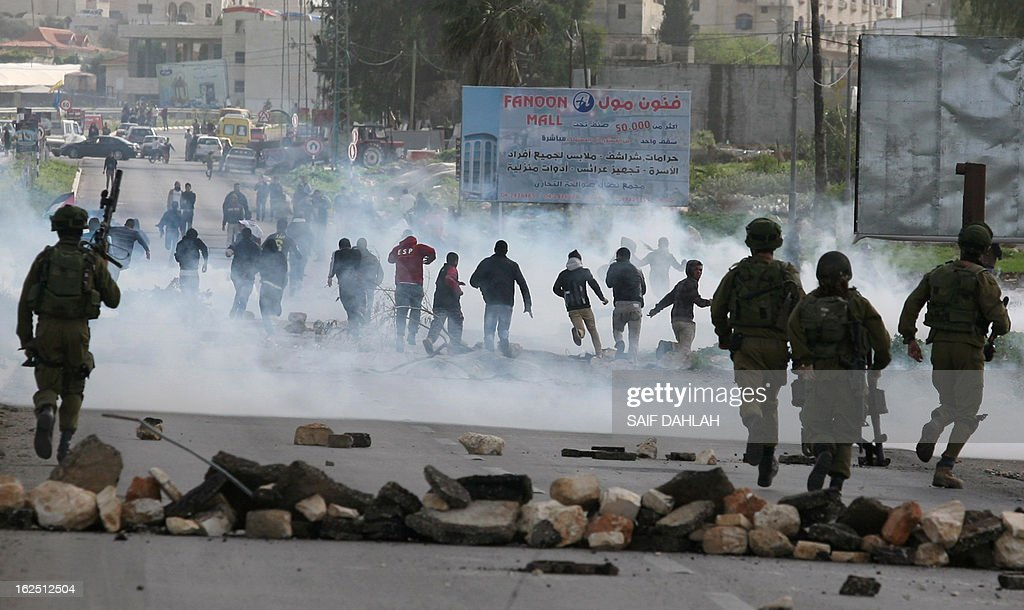 Palestinian youths clash with Israeli security forces at the entrance of the Jalama checkpoint, near the West Bank city of Jenin, on February 24, 2013. Israel demanded of Palestinian leaders to quell unrest as thousands of detainees in Israeli jails staged a one-day hunger strike a day after an inmate died, and their supporters clashed with security forces.