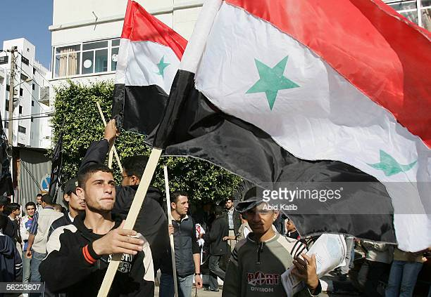 Palestinian youths hold Syrian flags during a proSyrian demonstration on November 18 2005 in Gaza City Gaza Strip Hundreds of Palestinians...