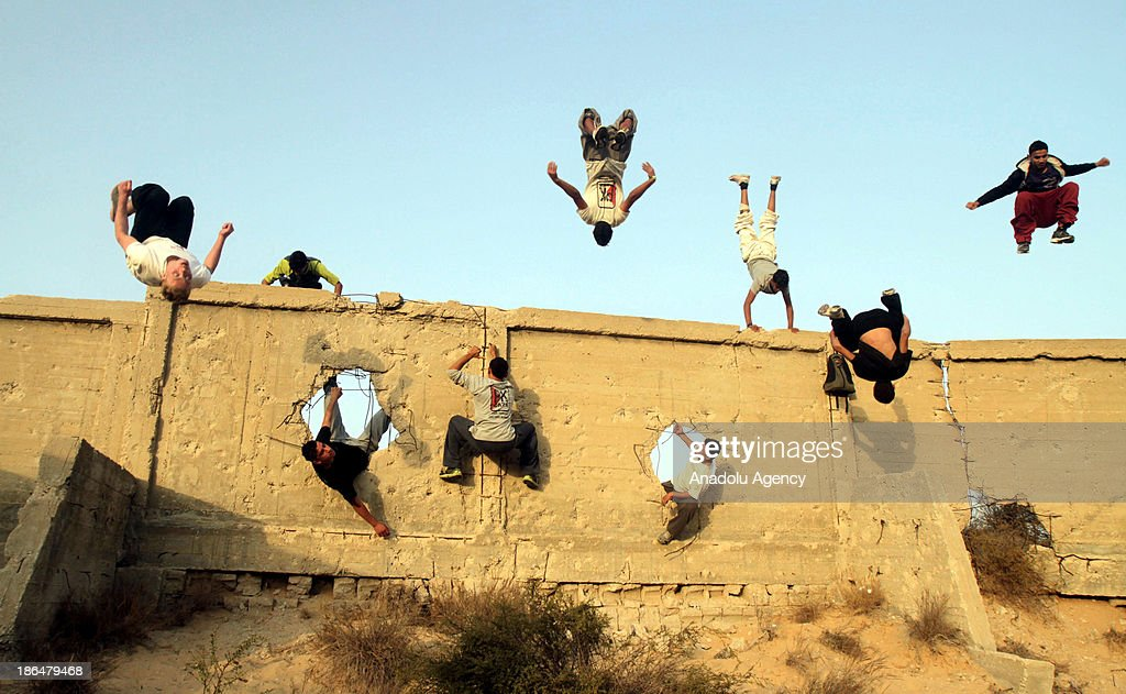 Palestinian youths practice their parkour skills in Gaza City on October 31, 2013. Parkour, French slang for the art of moving, is a physical activity that maximizes the body's efficiency with the aim of overcoming obstacles such as buildings, rails, and even people.