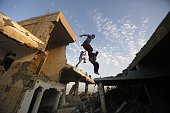 Palestinian youths practice their Parkour skills over the ruins of houses which were destroyed during the 50day Gaza war between Israel and Hamasled...