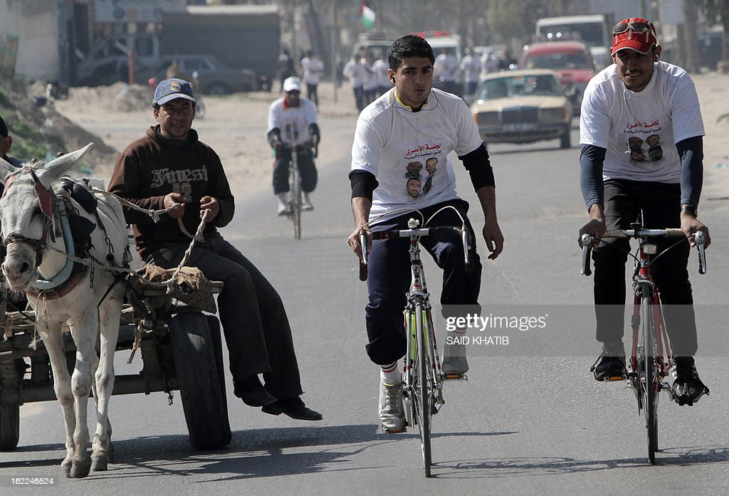 Palestinian youths ride their bicycles in solidarity with fellow prisoners held in Israeli jails inthe southern Gaza Strip town of Khan Yunis on February 21, 2013. Israel's Supreme Court rejected the previous day an appeal by a hunger-striking Palestinian prisoner, saying it was not authorised to overrule the restrictive military order under which he had been jailed.