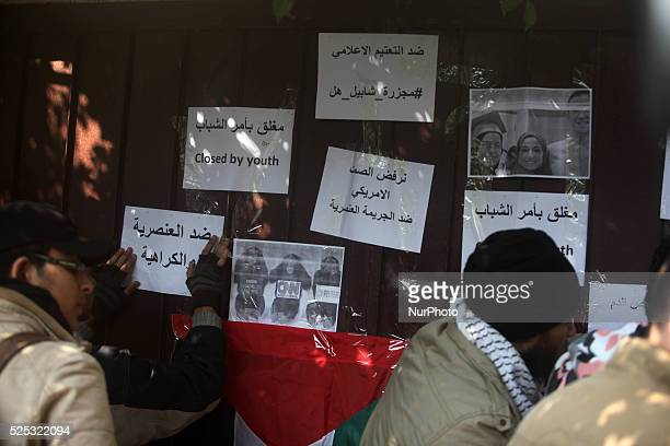 Palestinian youths take part in a rally outside the offices of the US humanitarian organisation CARE in Gaza City on February 16 in solidarity with...