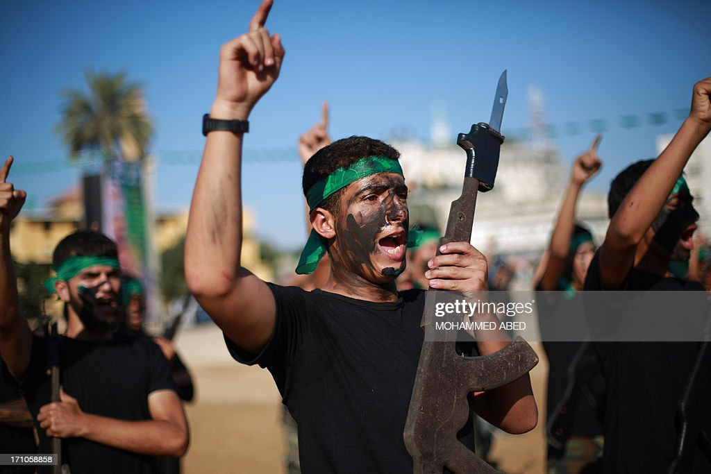 Palestinian youths take part in a summer physical training camp run by Hamas in Gaza City on June 21, 2013.