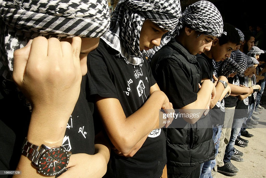 Palestinian youths wearing the traditional chequerred keffiyeh attend a rally held in the Palestinian refugee camp of Ain el-Helweh on the outskirts of the southern Lebanese city of Sidon on November 16, 2012, against Israel's military operation in the Gaza Strip. Thousands of people across the Middle East protested on Friday against Israel's aerial bombardment of the Gaza Strip, with some chanting 'death to Israel' and others calling for the bombing of Tel Aviv. AFP PHOTO/MAHMOUD ZAYYAT