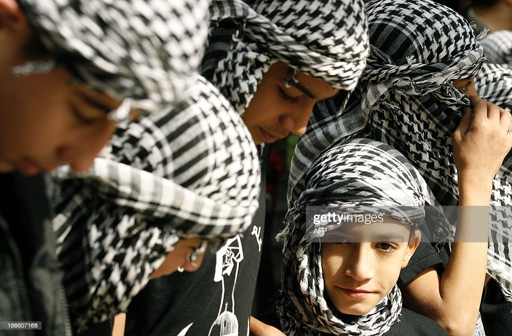 Palestinian youths wearing the traditional chequerred keffiyeh attend a rally held in the Palestinian refugee camp of Ain el-Helweh on the outskirts of the southern Lebanese city of Sidon on November 16, 2012, against Israel's military operation in the Gaza Strip. Thousands of people across the Middle East protested on Friday against Israel's aerial bombardment of the Gaza Strip, with some chanting 'death to Israel' and others calling for the bombing of Tel Aviv.