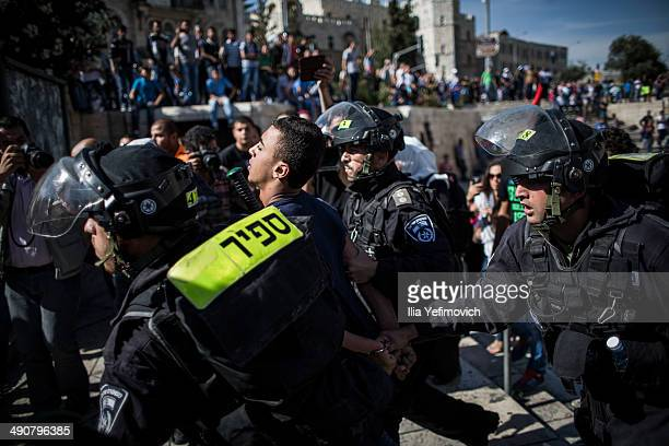 Palestinians are arrested during a rally marking Nakba day on May 15 2014 outside Damascus gate in Jerusalem Israel Palestinians mark Israel's...