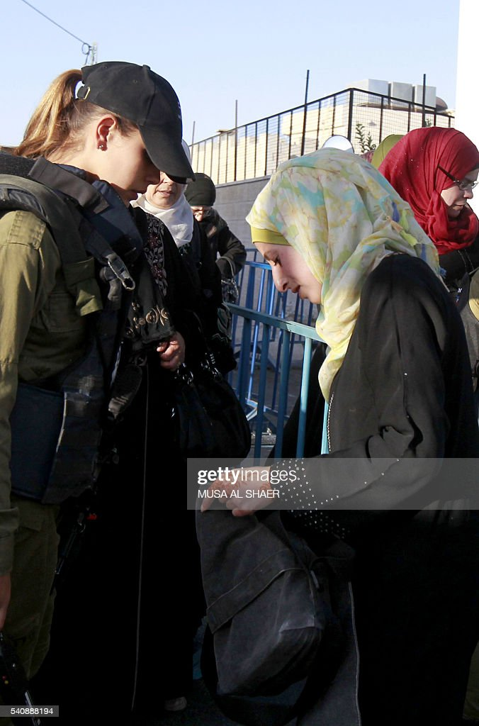Palestinians are checked at an Israeli checkpoint between the West Bank town of Bethlehem and Jerusalem as Muslim worshippers head to Friday noon...