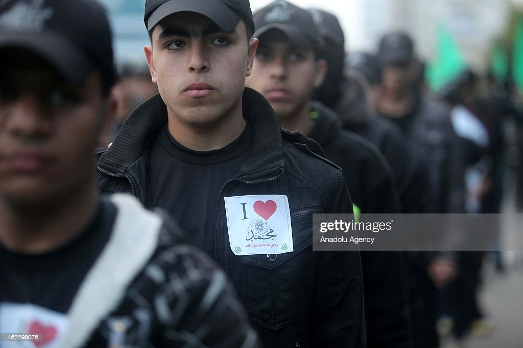 Palestinians are seen during a demonstration, organized by Hamas youths, against the printing of satirical cartoons of Muslim's Prophet Mohammad by French magazine Charlie Hebdo, in Gaza City, Gaza on January 26, 2015.