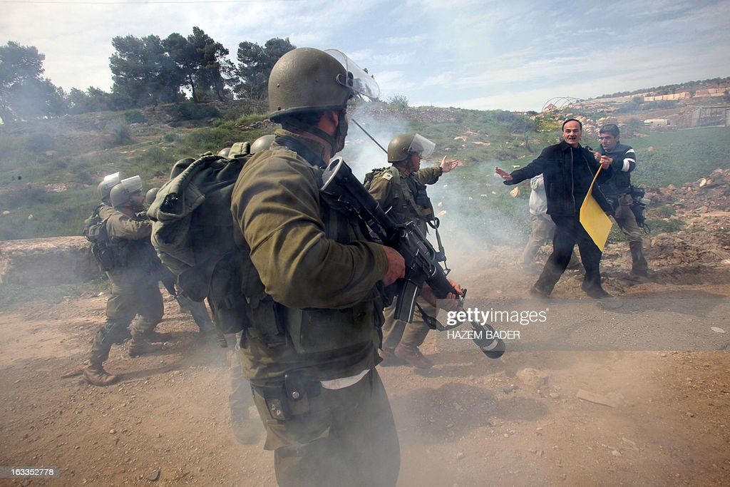 Palestinians argue with Israeli soldiers during clashes following a protest against the expropriation of Palestinian land by Israel on March 1, 2013, near the israeli settlement of Hagay in the West bank town of Hebron.