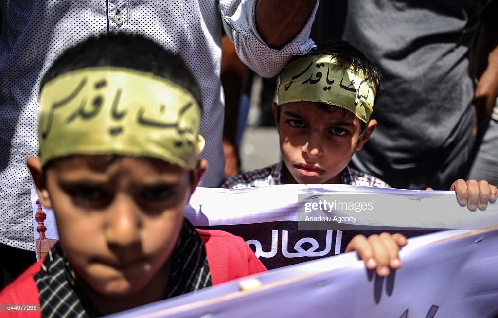Palestinians attend a rally to mark the International Quds Day on July 01, 2016 in Gaza City, Gaza on July 1, 2016.