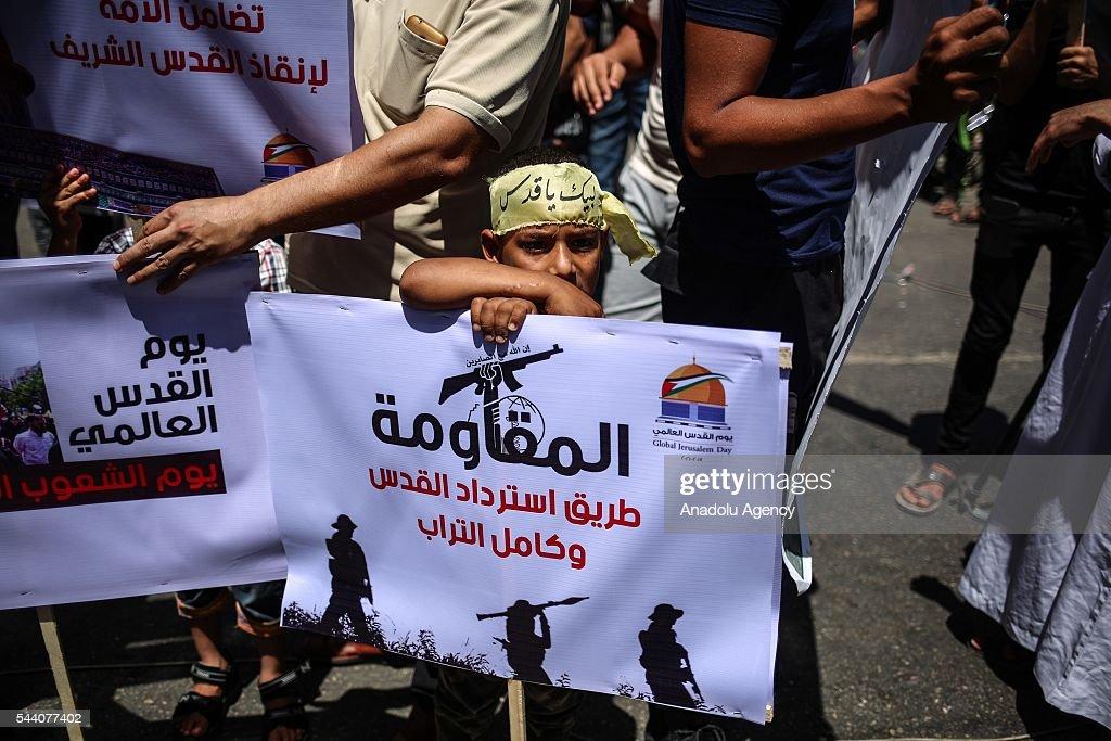 Palestinians attend a rally to mark the International Quds Day on July 01, 2016 in Gaza City, Gaza on July 1, 2016.