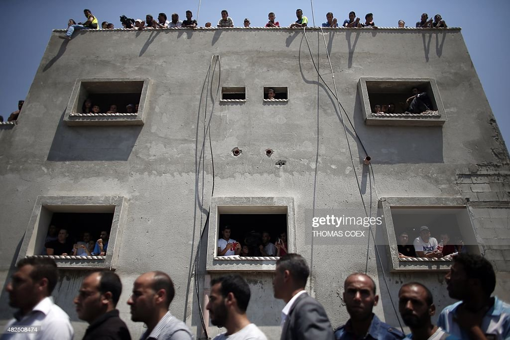 Palestinians attend the funeral of 18monthold Palestinian toddler Ali Saad Dawabsha who died after his house was set on fire by Jewish settlers on...