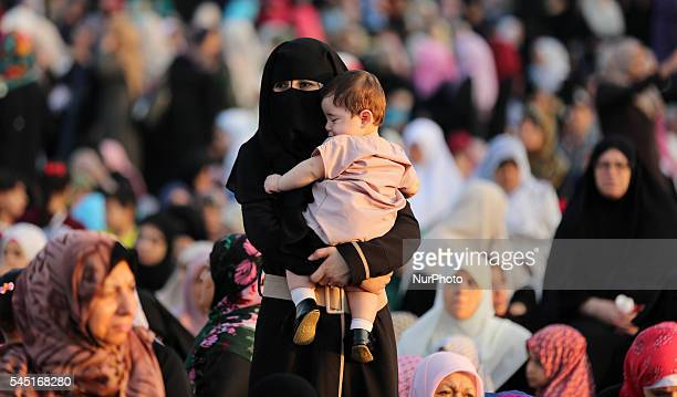 Palestinians attend the morning prayers for Eid alFitr celebrations which marks the end of the holy fasting month of Ramadan in Gaza City July 6 2016