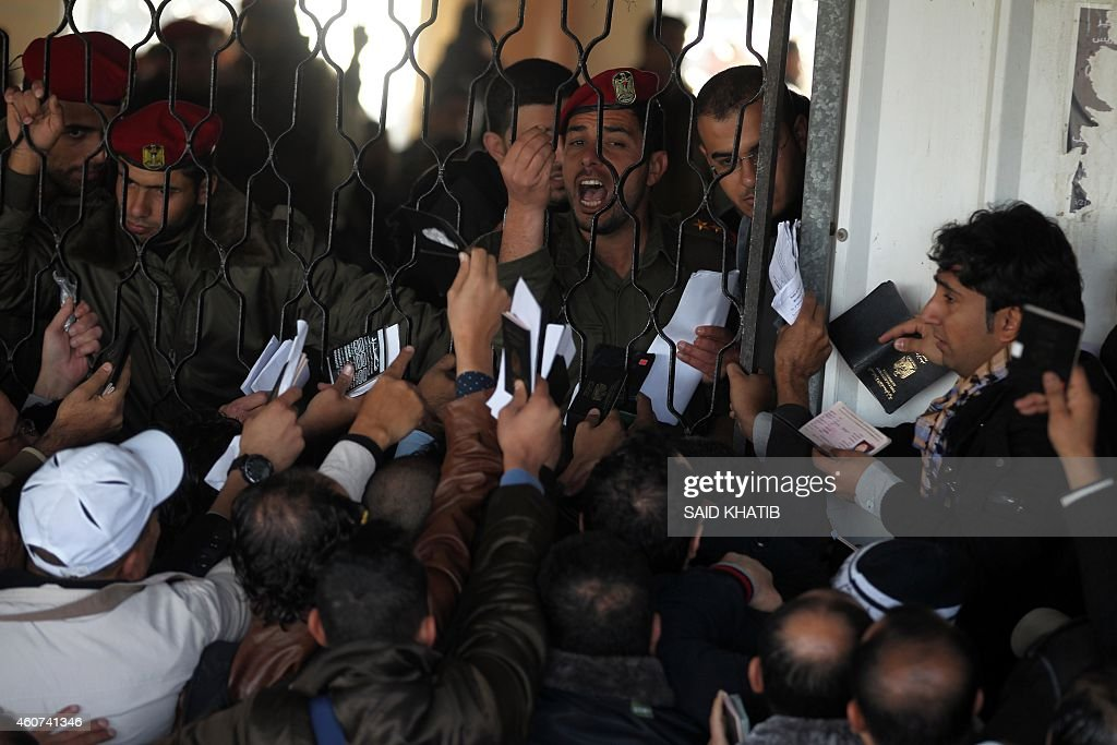 Palestinians await permission to enter Egypt as they gather inside the Rafah border crossing between Egypt and southern Gaza Strip on December 21, 2014. Egypt is set to reopen the Rafah border crossing with Gaza for the second time in two months to allow those stranded in Egypt to enter the Palestinian territory, officials said.