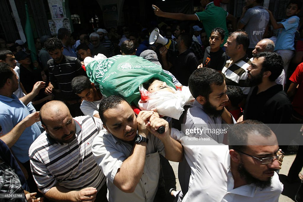 Palestinians carry one of the bodies of six men during the funeral of nine people in Khan Yunis, in the southern Gaza Strip. Israeli airstrikes and shelling killed more than 48 people across Gaza today, among them children, raising the toll in 12 days of violence to 333, medics said.