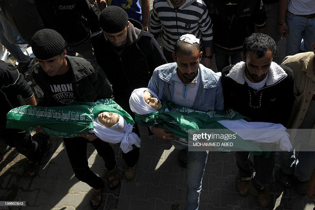 Palestinians carry the body of Jumana Abu Sefan (L), 18 months, and her brother Tamer, three and a half years old, during their funeral in the village of Beit Lahia, in the northern Gaza Strip on November 18, 2012. A ground invasion of the Gaza Strip would lose Israel much international sympathy and support, British Foreign Secretary William Hague warned. AFP PHOTO/MOHAMMED ABED