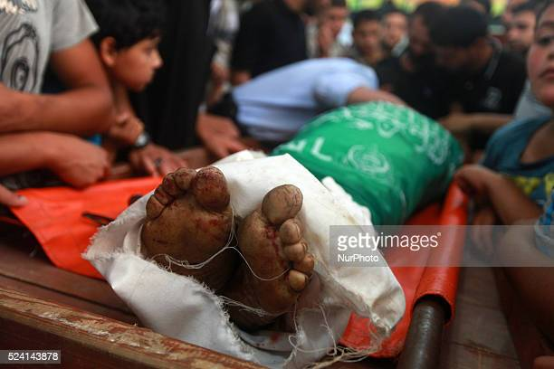 Palestinians carry the body of Mohammed Alaawor who was killed after an Israeli air strike on a motorcycle in Beit Lahia northern Gaza Strip on...